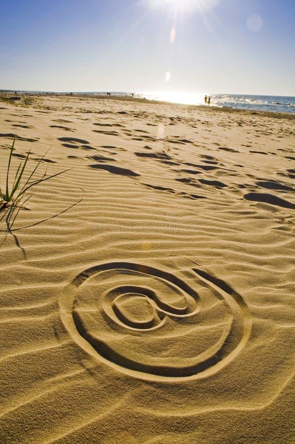 plaża rysujący piaska znak zdjęcia stock