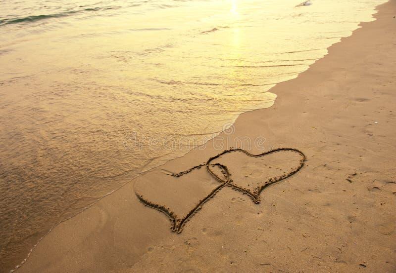 plaża rysujący serca dwa obrazy royalty free