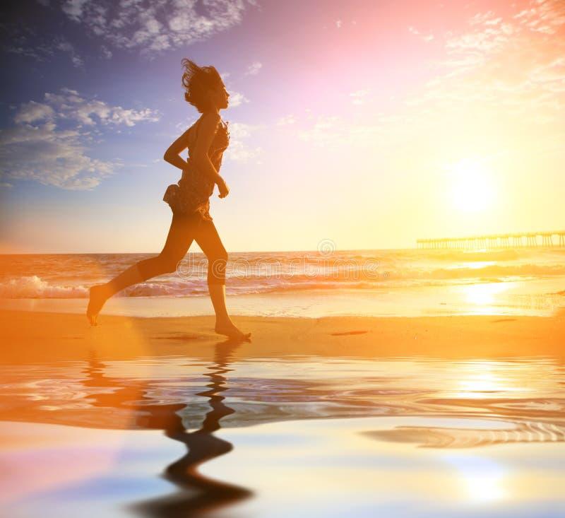 plażowa działająca kobieta obraz royalty free