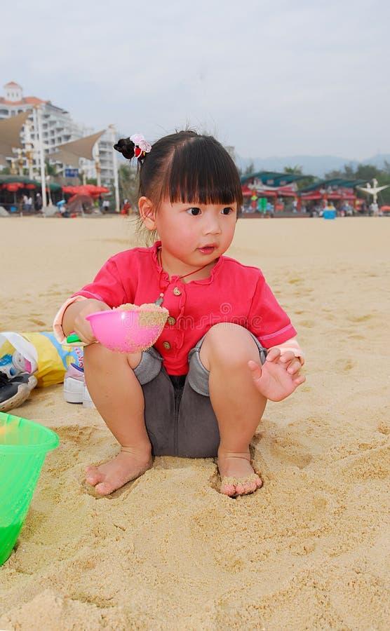 plażowego dziecka chiński bawić się obraz royalty free