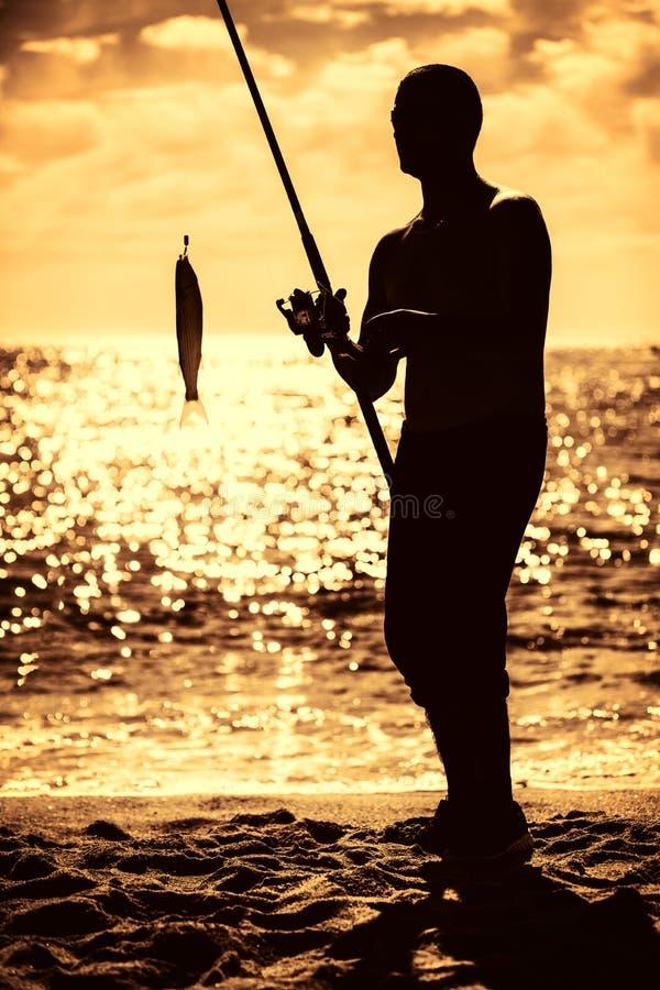 plażowi rybacy obrazy royalty free