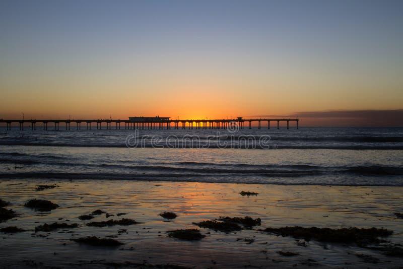 plażowy oceanu mola zmierzch obrazy royalty free