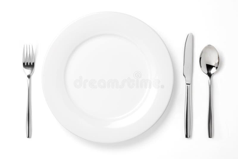 Plaat met lepel, mes en vork royalty-vrije stock foto's