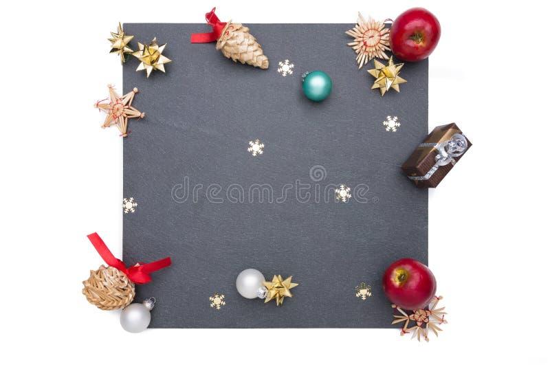 Plaat van lei met Kerstmispunten stock foto