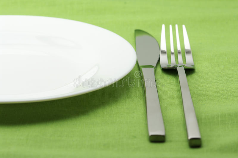 Plaat, vork en mes royalty-vrije stock afbeelding