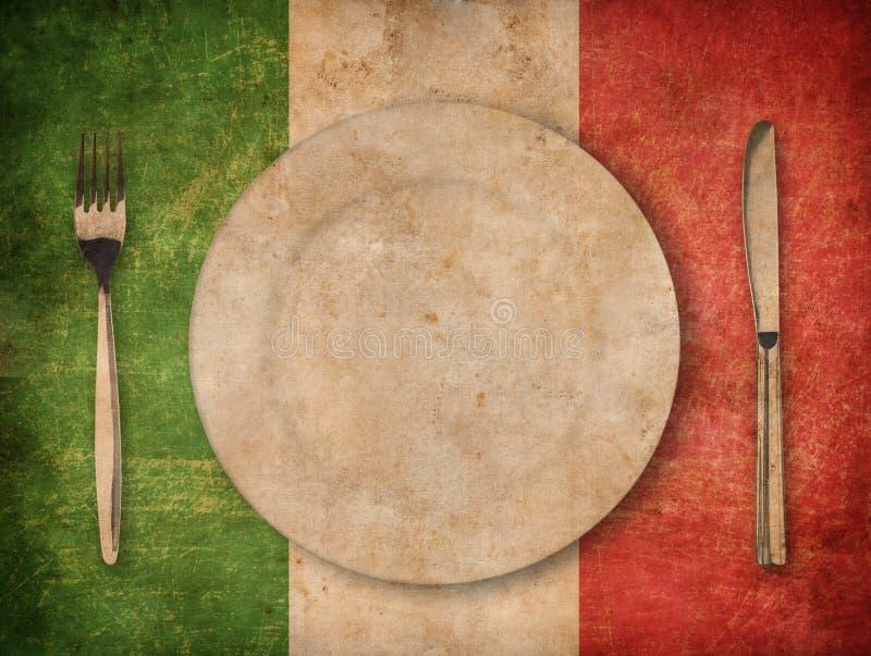 Plaat, vork en mes op achtergrond van de grunge de Italiaanse vlag stock afbeelding