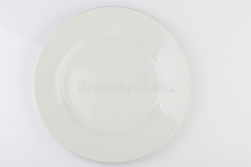 Placa blanca de la ronda limpia vacía fotografía de archivo
