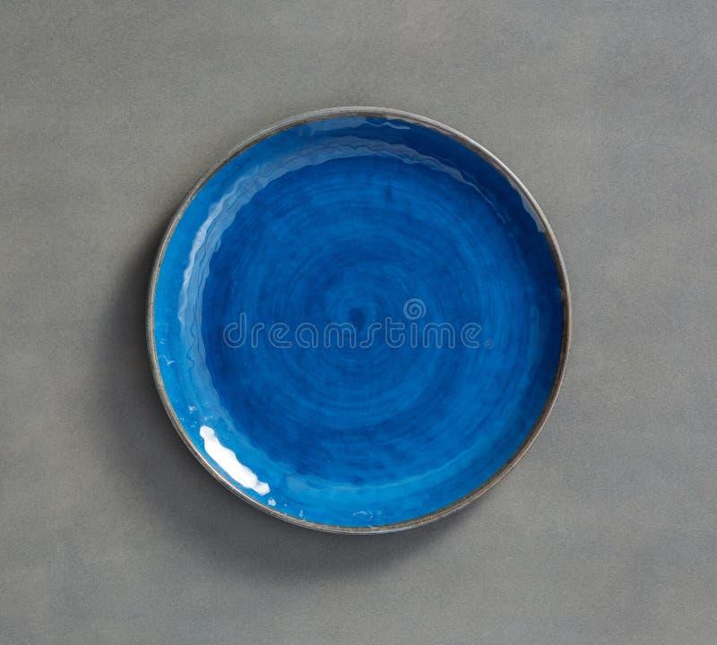 Placa branca da melamina com luz - backgroundBlue cinzento roda a melamina chapeia com o claro - fundo cinzento imagem de stock royalty free