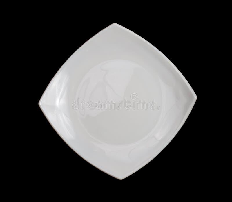 Placa branca quadrada isolada no preto fotografia de stock royalty free