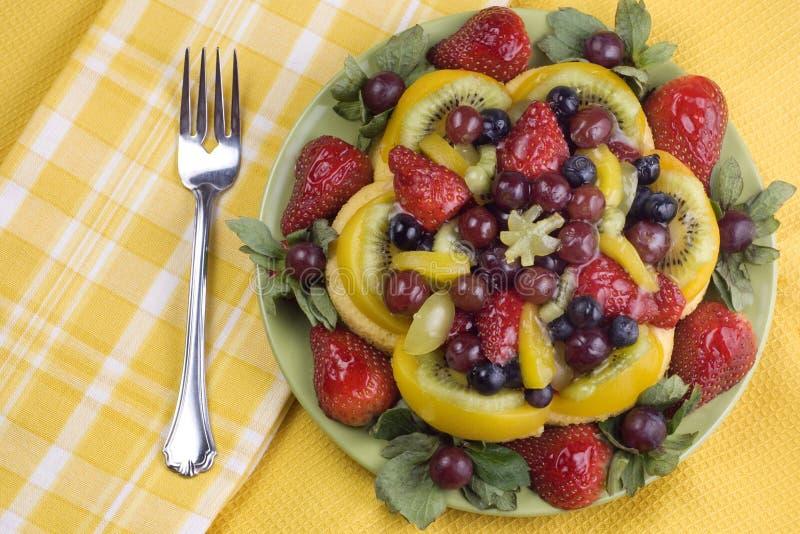 Placa colorida de la fruta esmaltada imagen de archivo