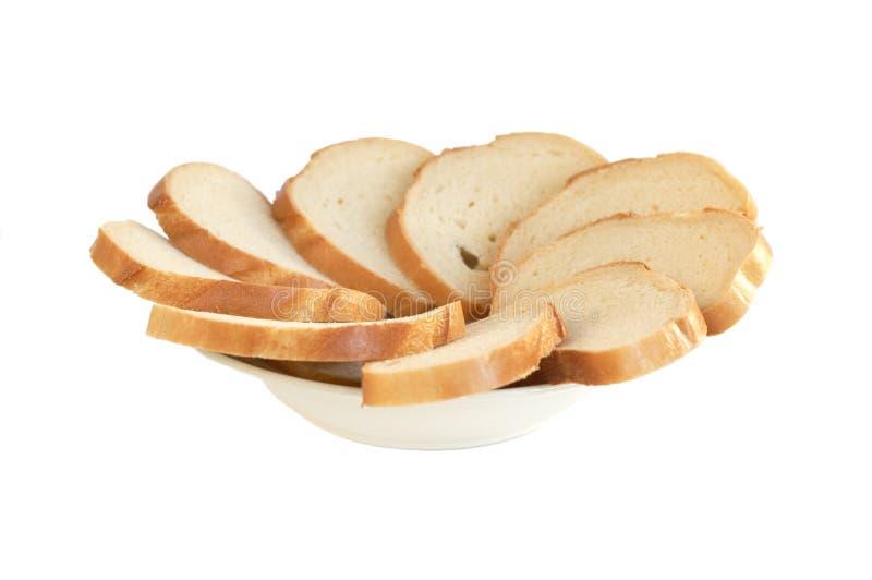 Placa com fatias do pão imagens de stock royalty free
