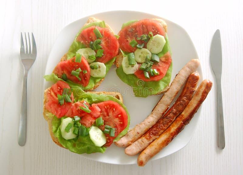 Placa com sanduíches fotografia de stock royalty free