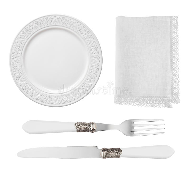 Placa, cuchillo, bifurcación y servilleta del vintage aislados en el fondo blanco foto de archivo libre de regalías