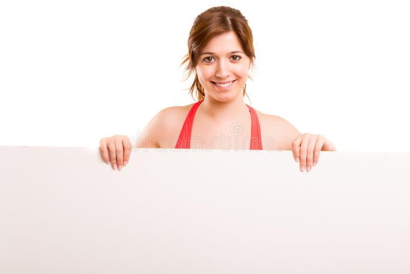 Placa da placa da posse da mulher da aptidão do esporte fotografia de stock