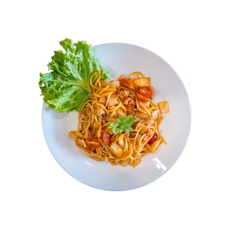Placa da vista superior dos espaguetes italianos deliciosos com molho de tomate fotografia de stock