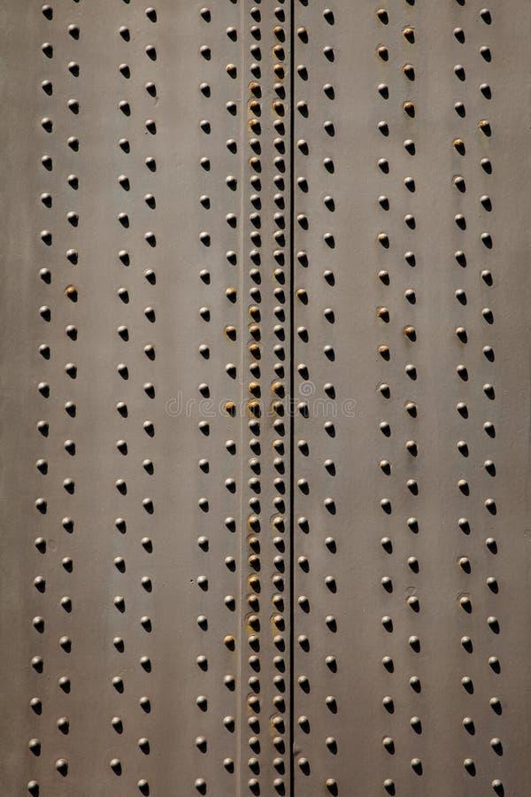 Placa de aço e rebites imagens de stock