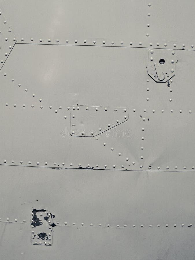Placa de acero con los tornillos imagen de archivo libre de regalías