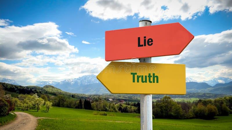 Placa de calle a la verdad contra mentira foto de archivo