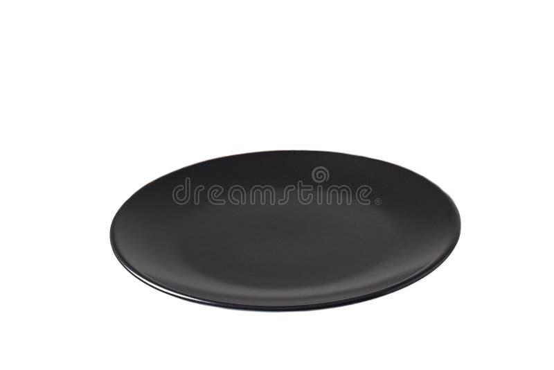 Placa de cerámica negra aislada en el fondo blanco imágenes de archivo libres de regalías