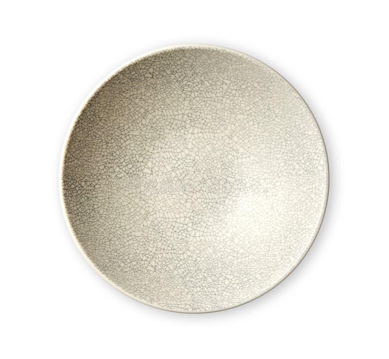 Placa de cerámica oriental moderna en el modelo agrietado, placas de marfil vacías, visión desde arriba aisladas en el fondo blan foto de archivo