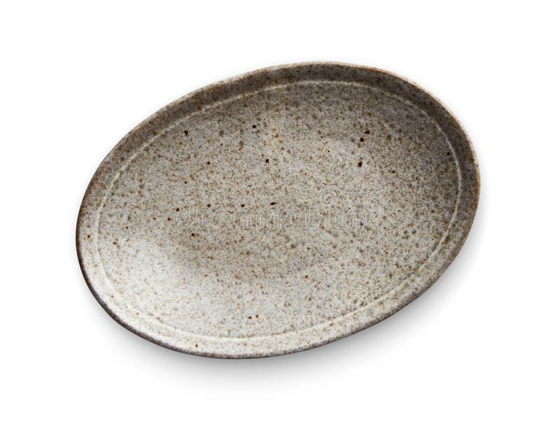 Placa de cerámica oval, placa vacía con la textura del granito, visión desde arriba aislada en el fondo blanco con la trayectoria fotografía de archivo