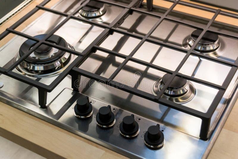 Placa de Chrome do fogão de gás Quatro botões de controle kitchenware fotos de stock royalty free