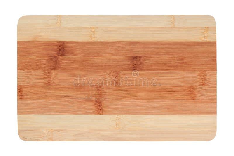 Placa de corte marrom nova da cozinha feita do bambu Isolado no fundo branco imagens de stock