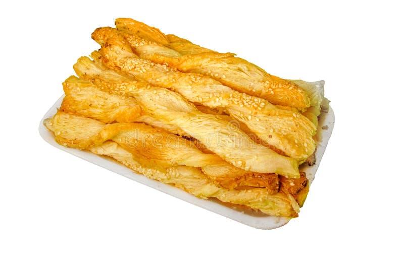 A placa de filhóses chinesas Fritters o café da manhã popular do chinês foto de stock