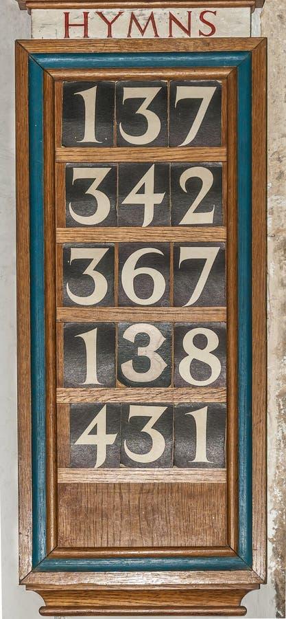 Placa de madeira do hino foto de stock