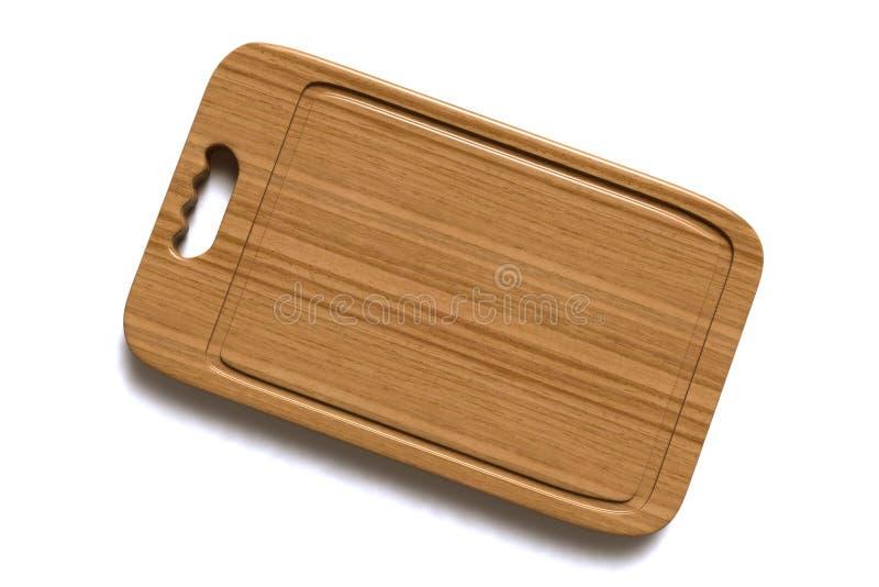 Placa de madeira para a carne e a placa de corte de madeira vegetal em um fundo branco foto de stock royalty free
