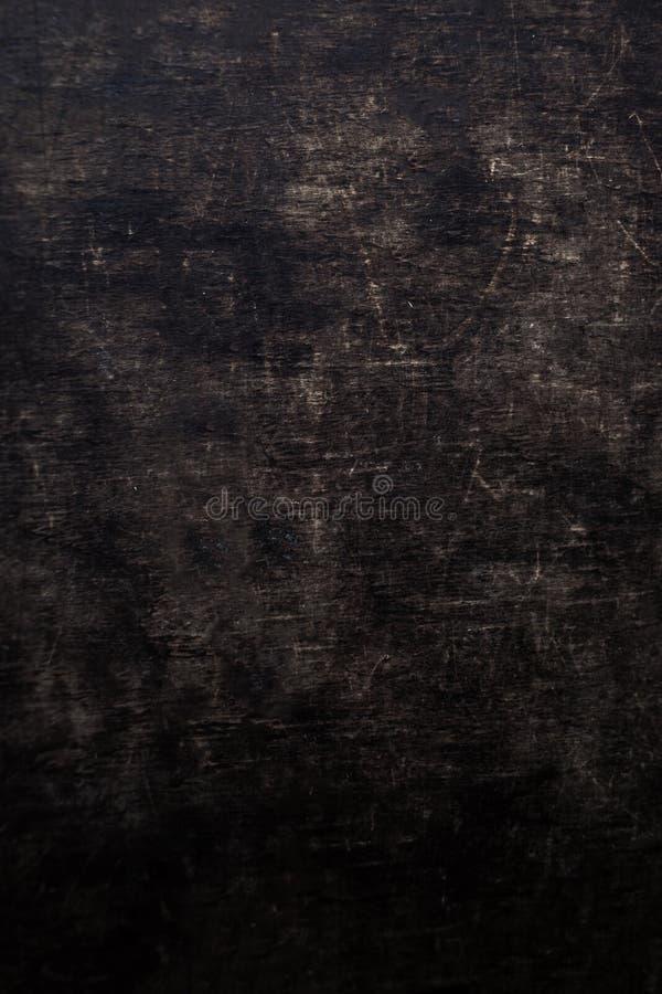 Placa de madeira riscada obscuridade do grunge Textura de madeira preta foto de stock royalty free