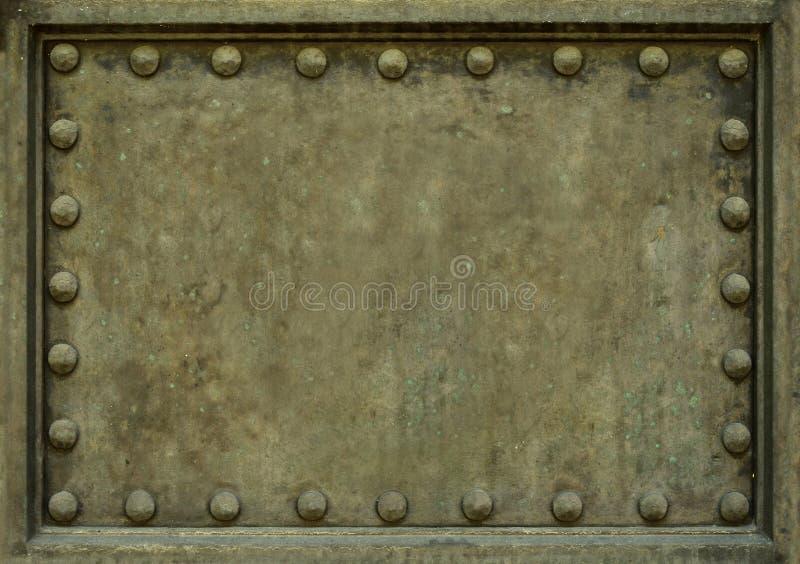 Placa de metal con los remaches foto de archivo libre de regalías