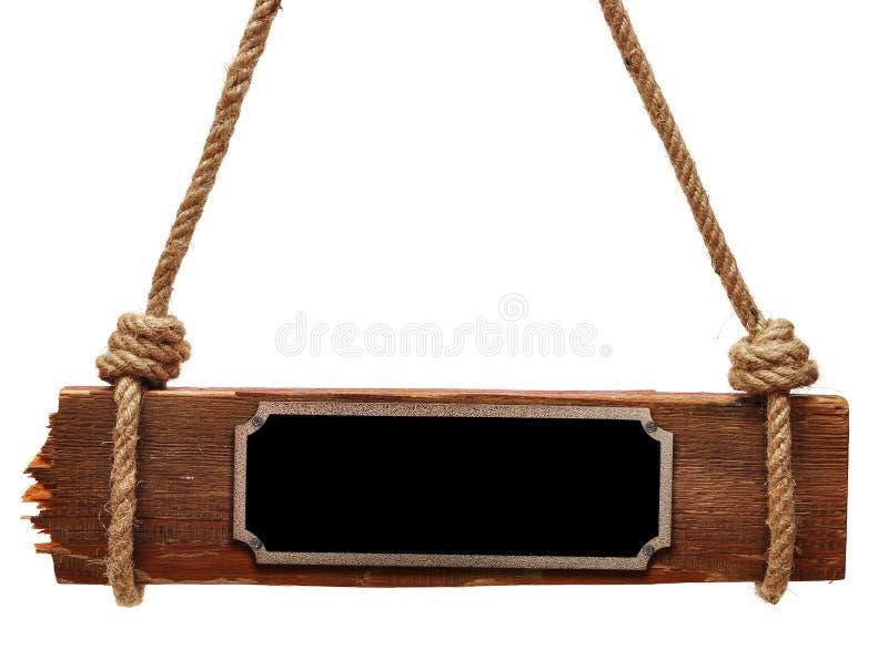 Placa de metal no quadro indicador de madeira imagem de stock