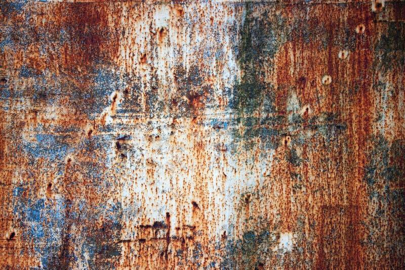 Placa de metal oxidada com pintura gasto, fundo da textura do ferro imagem de stock