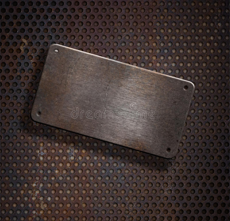 Placa de metal oxidada de Grunge sobre o fundo da grade imagens de stock
