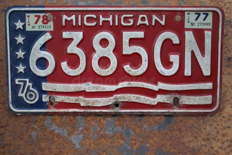 Placa de Michigan los E.E.U.U. en un fondo oxidado del metal imágenes de archivo libres de regalías