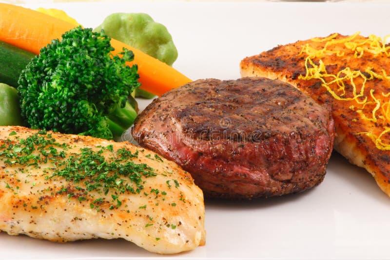 Placa de três carnes imagem de stock