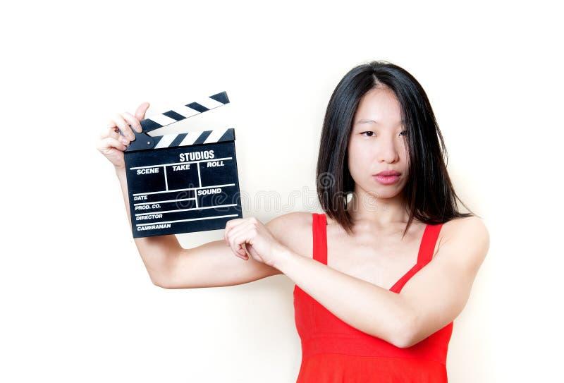 Placa de válvula asiática nova da mulher e do filme fotografia de stock