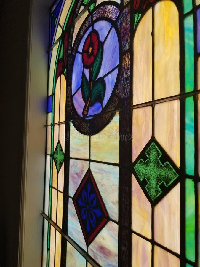 Placa de vidro colorida da janela da igreja imagem de stock royalty free