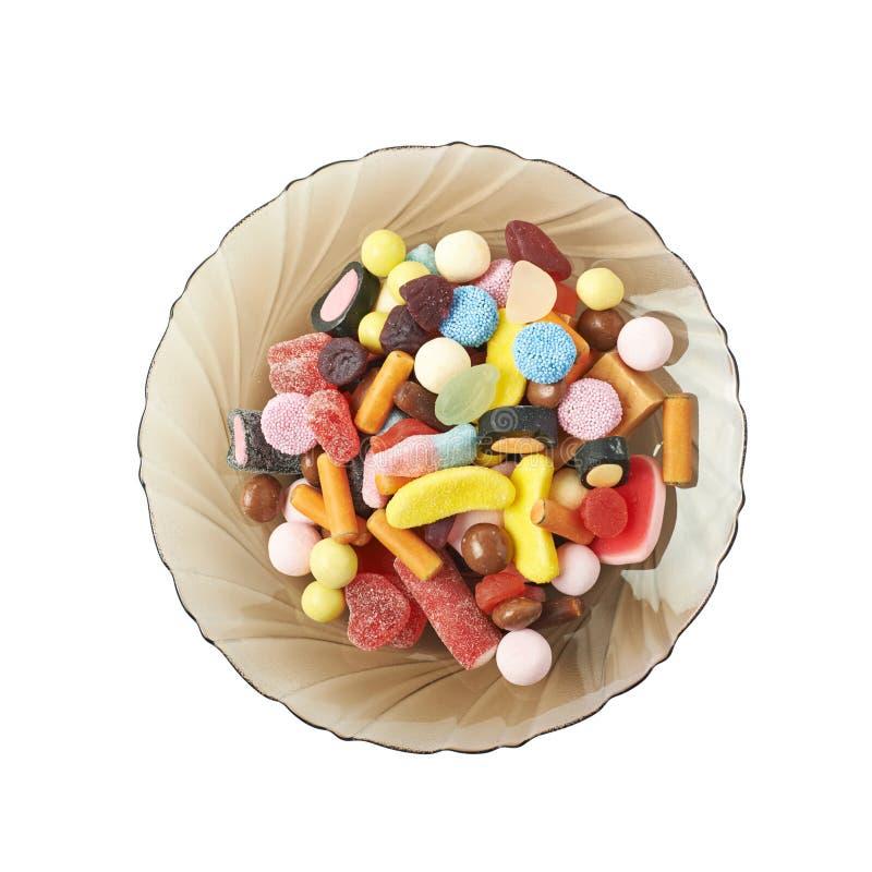 Placa de vidro completamente dos doces isolados imagens de stock royalty free