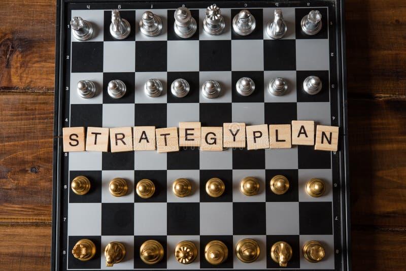 Placa de xadrez e conceito estratégico do planeamento empresarial do ` do plano do ` do texto fotografia de stock royalty free