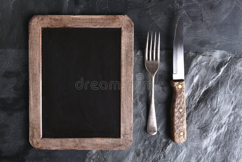 Placa do menu da faca da forquilha foto de stock