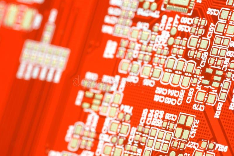 Placa do vermelho do circuito Tecnologia de material informático eletrônica Microplaqueta digital do cartão-matriz imagens de stock royalty free