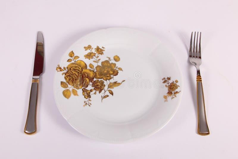 Placa, fork y cuchillo fotos de archivo