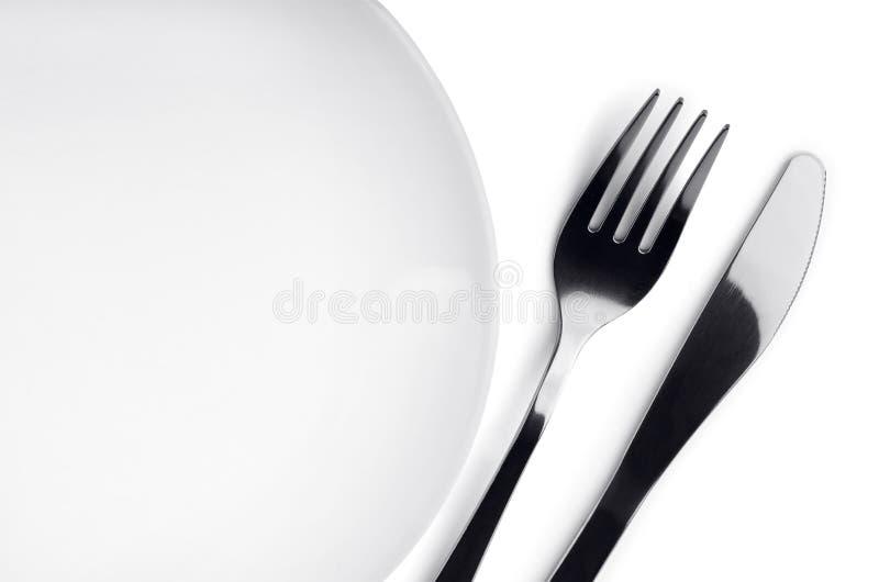 Placa, fork y cuchillo imagen de archivo