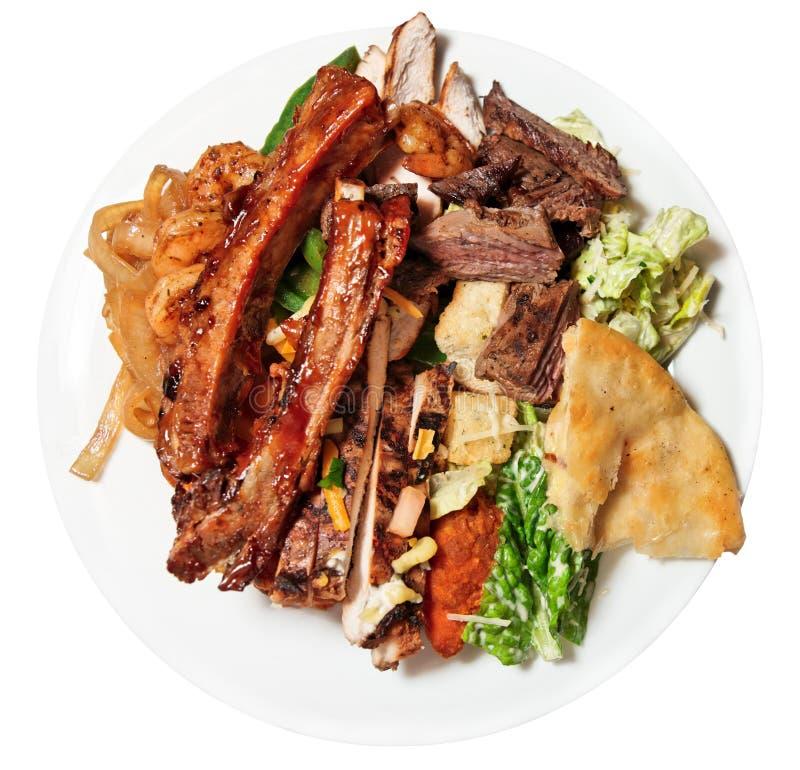 Placa grande con el surtido de alimentos imagen de archivo