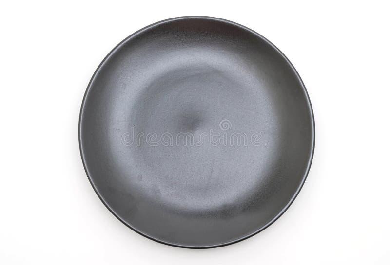 placa negra y cuenco en el fondo blanco imágenes de archivo libres de regalías