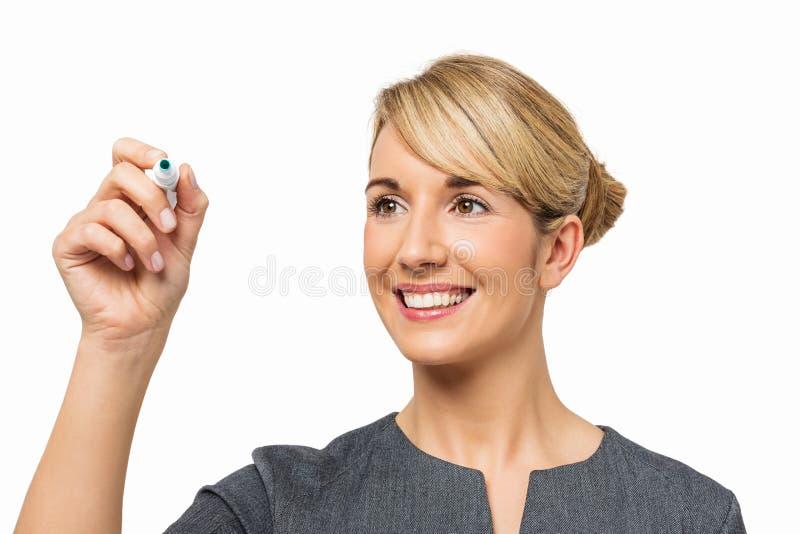 Placa nova de Writing On Transparent da mulher de negócios foto de stock royalty free