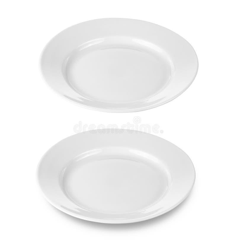 Placa ou prato redondo isolada com trajeto de grampeamento fotografia de stock