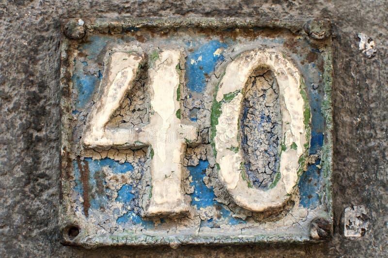 Placa retro velha número 40 do ferro fundido foto de stock